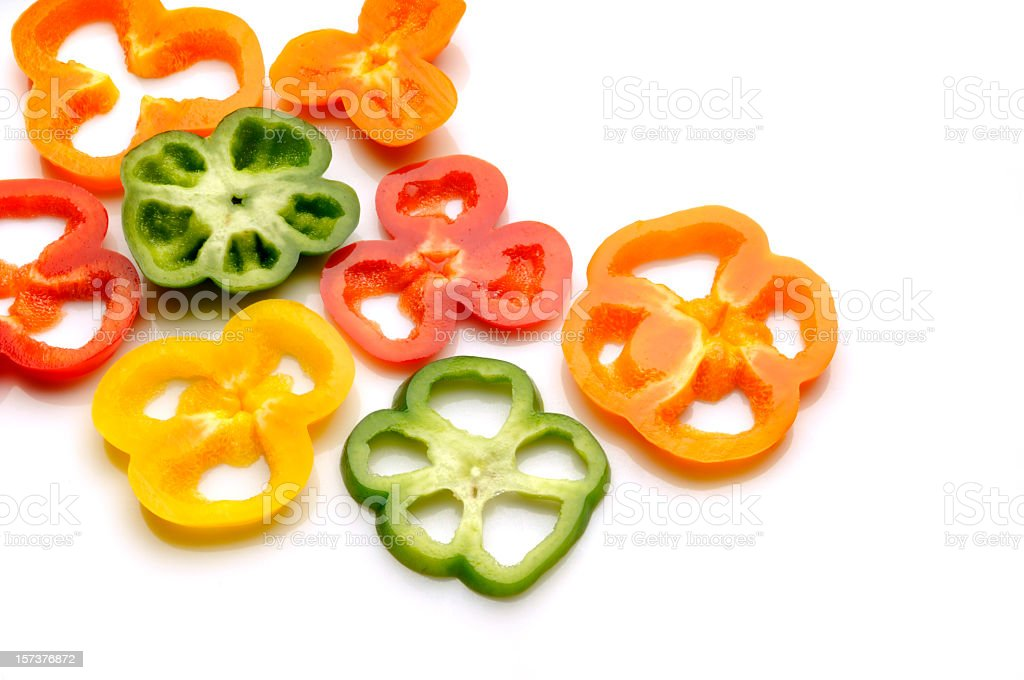 Moist Yellow, Red, Orange, Green Pepper Slices on White Background stock photo