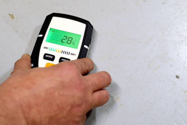 Moisture measuring Measuring moisture in concrete floor. Space for text. meter instrument of measurement stock pictures, royalty-free photos & images