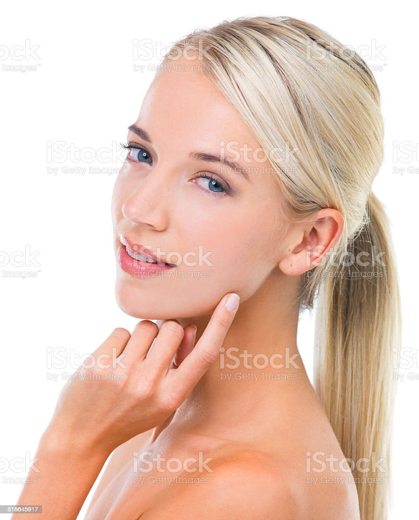 Moisturising is ALWAYS a good idea Studio shot of a beautiful blonde touching her face against a white background 20-24 Years Stock Photo