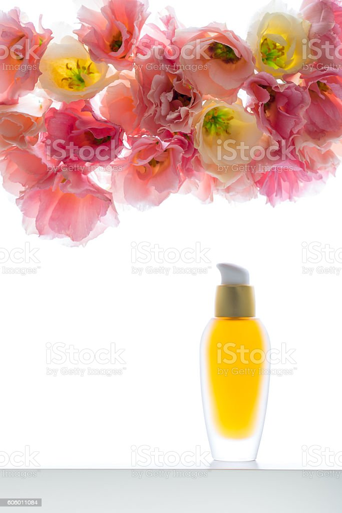 Moisturising serum for face skin with eustoma on  background stock photo