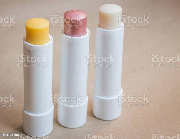 Moisturizer Lipstick On Brown Natural Background Stock Photo - Download Image Now