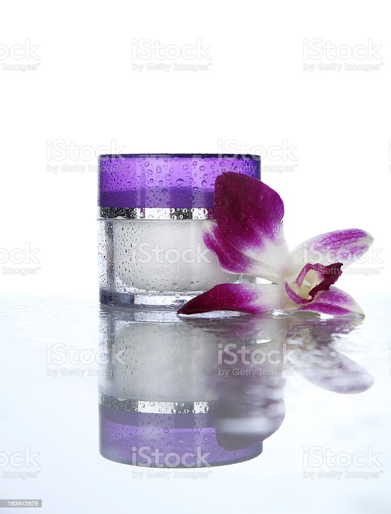 Moisturizer on white with orchid royalty-free stock photo