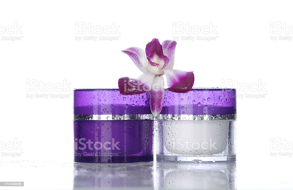 Moisturizers on white with orchid royalty-free stock photo
