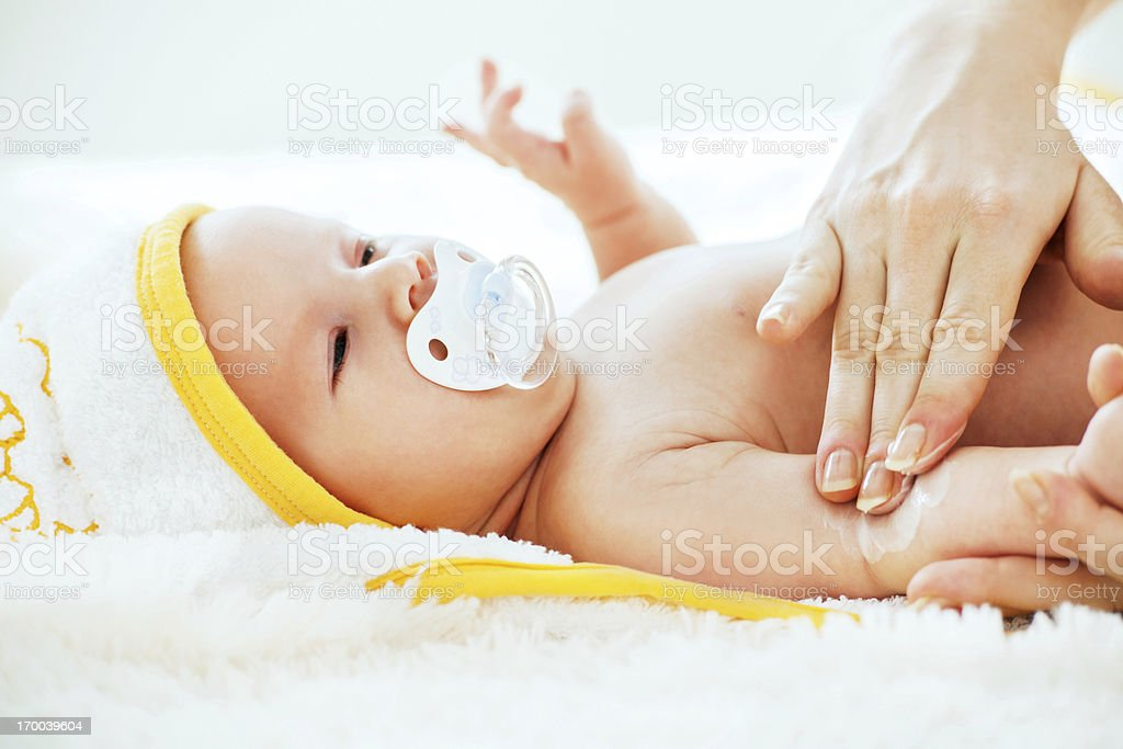 Moisturizing baby royalty-free stock photo