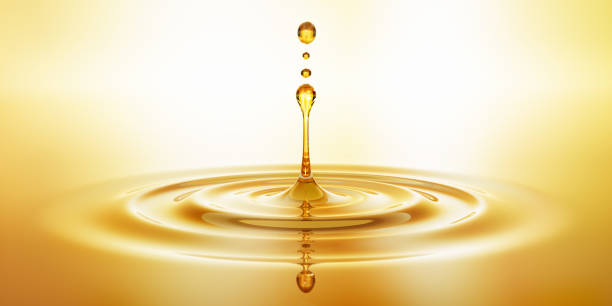 Gota de aceite cosmético hidratante con ondas - foto de stock