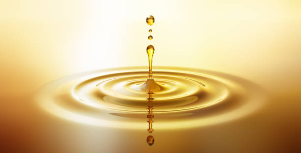 moisturizing cosmetic oil drop with ripples - crude stock pictures, royalty-free photos & images