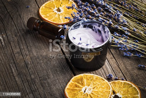 Moisturizing cream organic with a lavender and orange dry on a wooden table