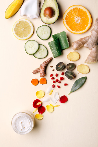 Organic, natural cosmetics with fruits and flower petals.