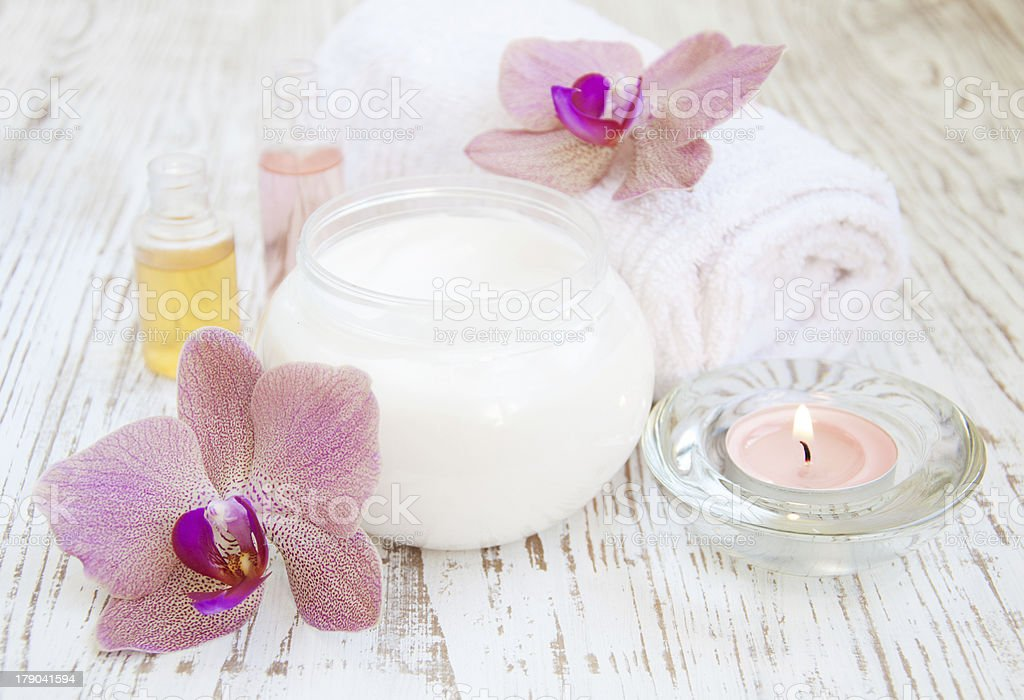 moisturizing cream with pink orchids royalty-free stock photo