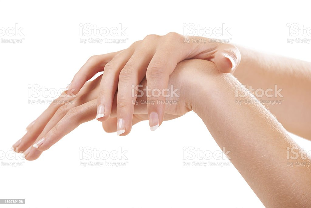 Moisturizing every inch of her hand royalty-free stock photo