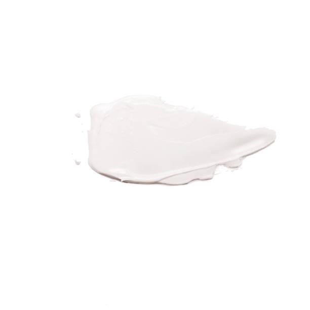 hydraterende gezichtscrème besmeurd beige geïsoleerd op witte achtergrond. - crèmekleurig stockfoto's en -beelden