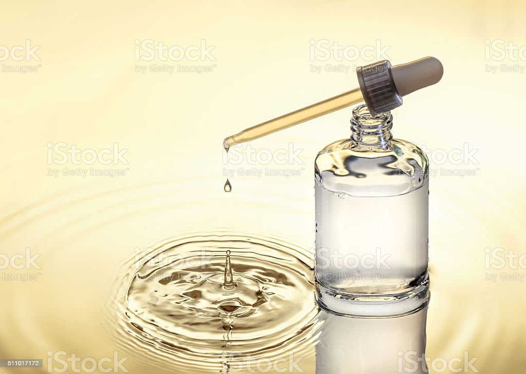 Moisturizing serum for dry skin, yellow background stock photo