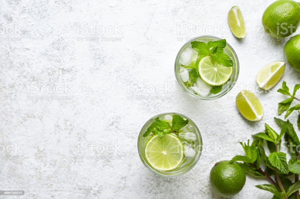 Mojito cocktail alcohol bar long drink traditional fresh tropical beverage top view copy space two highball glass stock photo