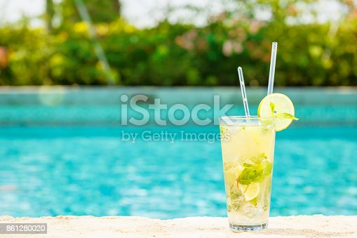 istock Mojito cocktail at the edge of a resort pool.  Concept of luxury vacation 861280020