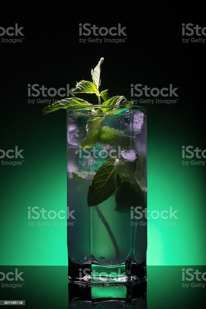 Mojito cocktail on dark green background stock photo
