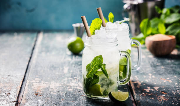 Mojito cocktail on wooden table stock photo