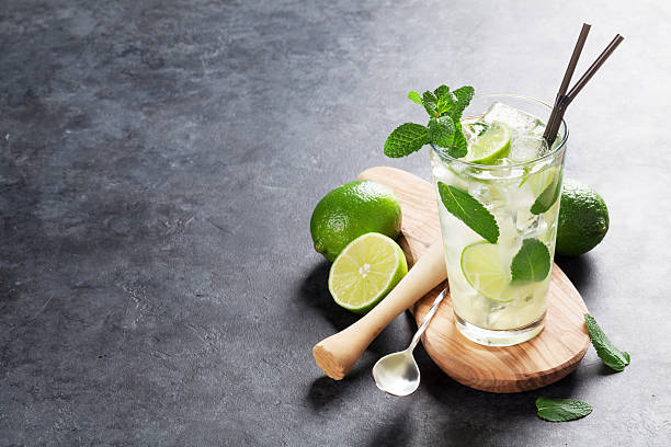 Mojito cocktail Mojito cocktail on dark stone table. With copy space for your text mojito stock pictures, royalty-free photos & images