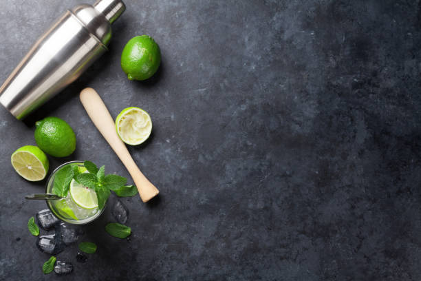 Mojito cocktail Mojito cocktail on dark stone table. Top view with copy space for your text cocktail shaker stock pictures, royalty-free photos & images