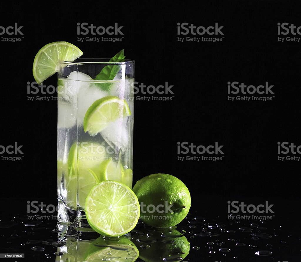 Mojito cocktail with fresh limes stock photo