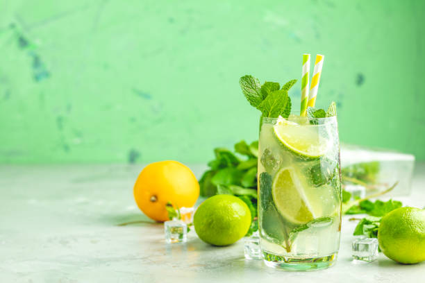 Mojito cocktail with lime and mint in highball glass stock photo
