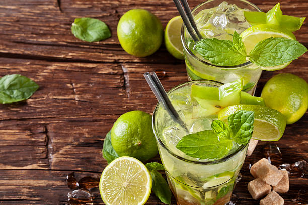 Mojito drinks on wooden planks Mojito drinks served on wooden planks mojito stock pictures, royalty-free photos & images