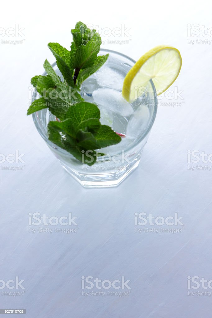 Mojito on summer vacation, cocktail with ice on a white background, a...