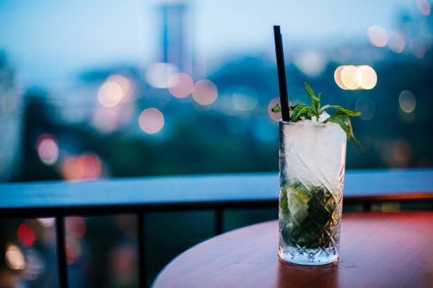 Mojito on wooden table at roof bar Mojito on wooden table at roof bar tonic water stock pictures, royalty-free photos & images