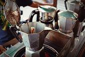moka pot Italian traditional coffee maker with hot coffee,making coffee in moka pot