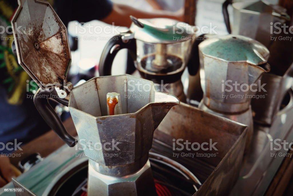 moka pot Italian traditional coffee maker with hot coffee stock photo