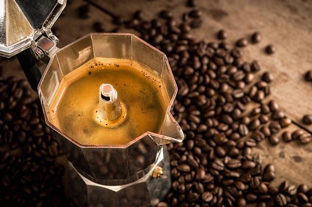 moka pot old coffee maker and coffee beans - mocca stock-fotos und bilder