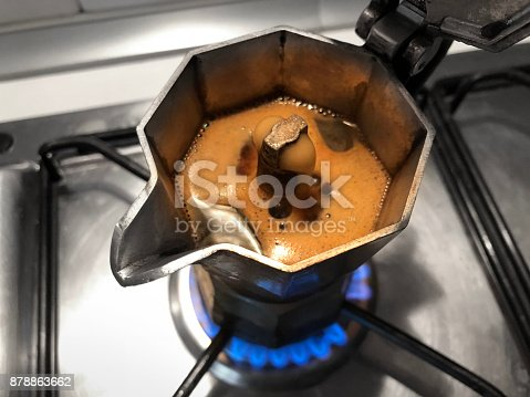 istock Moka with coffee on the stove top. Traditional italian coffee maker. 878863662