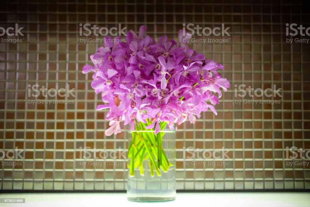 Mokara bouquet in glass pot decoration in room stock photo