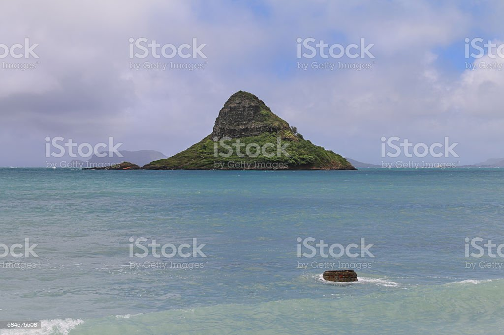 Mokolii island formerly known as Chinaman's Hat stock photo