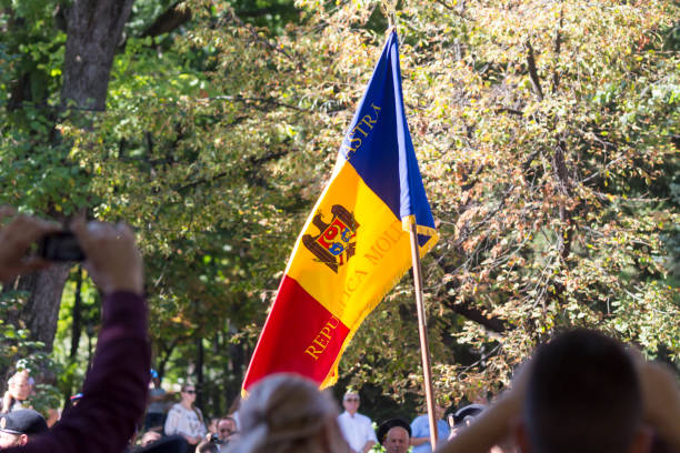 moldavian flag carried through the main street of chisinau, moldova during independence day celebrations - moldova stock pictures, royalty-free photos & images