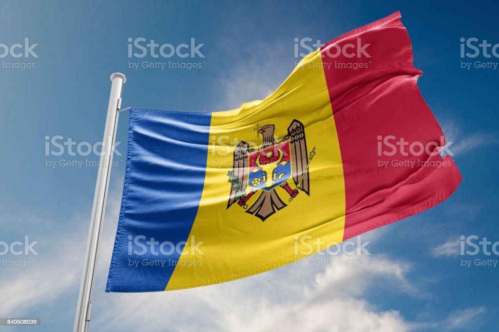 Moldova Flag is Waving Against Blue Sky stock photo