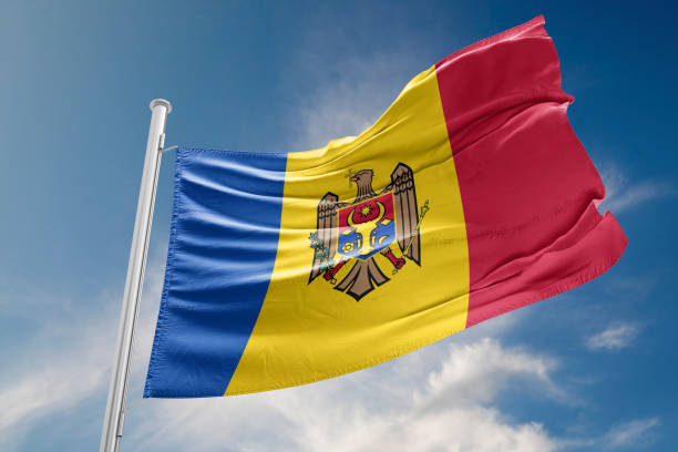 moldova flag is waving against blue sky - moldova stock pictures, royalty-free photos & images