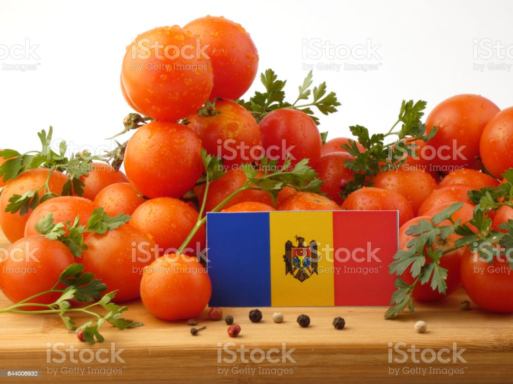 Moldovan flag on a wooden panel with tomatoes isolated on a white background stock photo