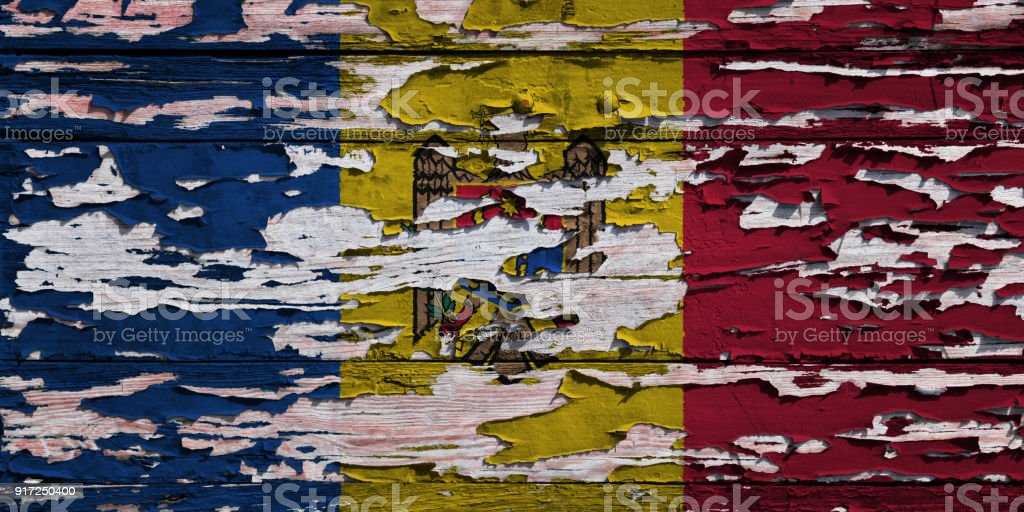 Moldovan flag painted on a grunge plank stock photo