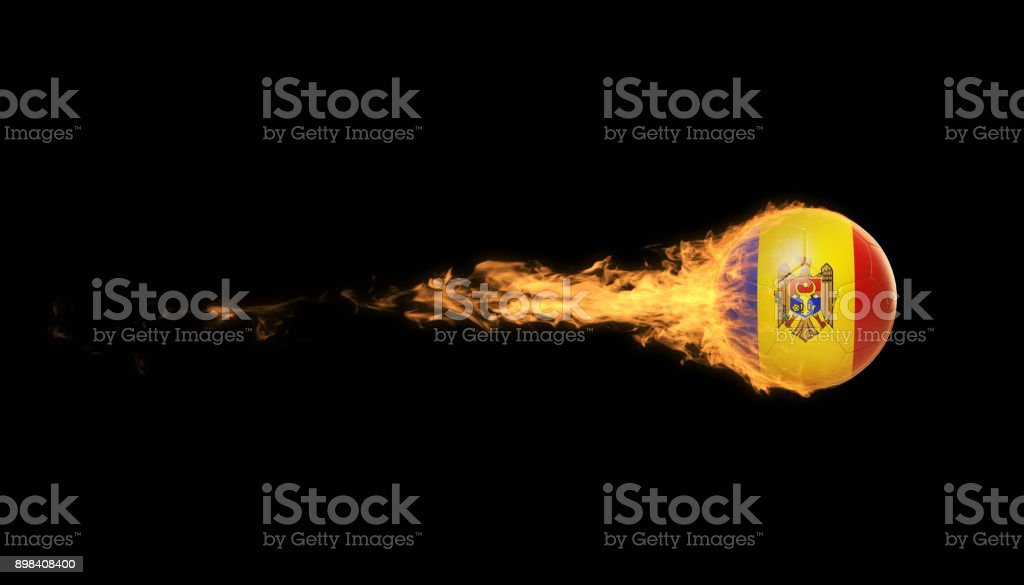 Moldovan Soccer Ball In Flames Over Black Background stock photo