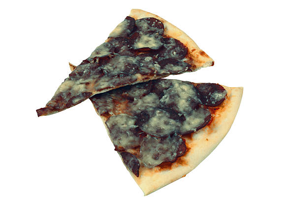 Moldy slices of cheese pizza stock photo
