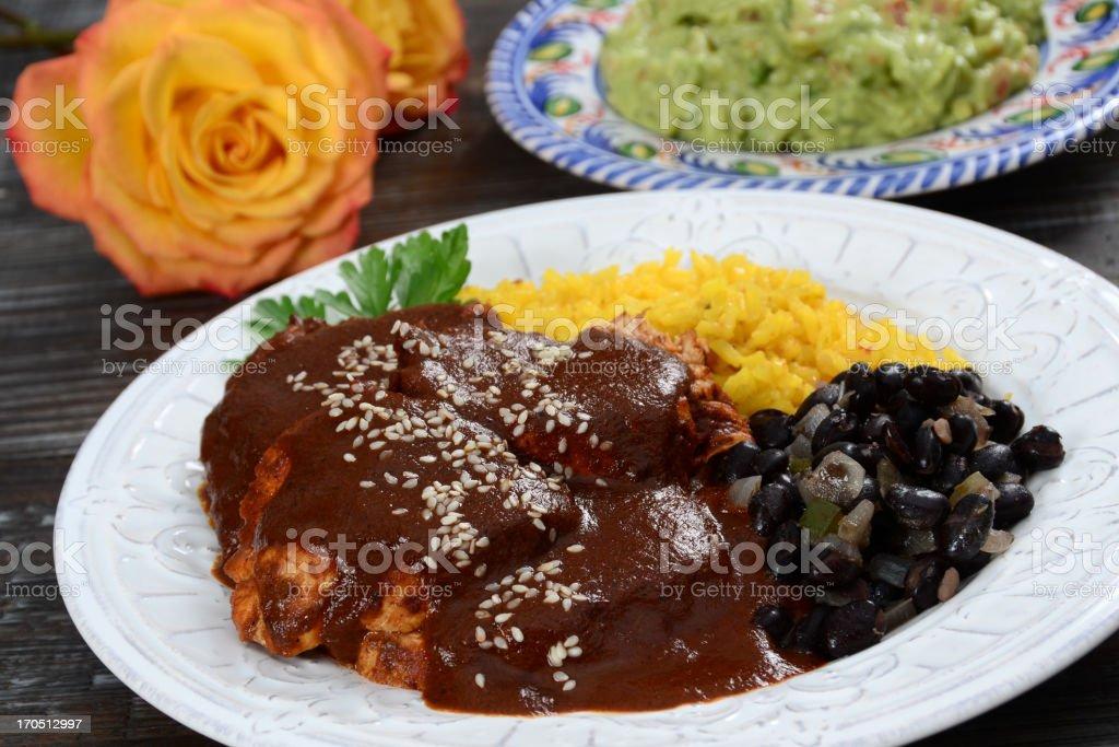 Mole poblano de guajolote on white plate stock photo