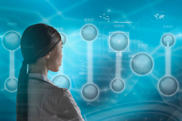 Molecular Biology, Genetics and Medical Concept. An Asian woman doctor, scientist or biologist is working in a futuristic, augmented reality virtual space, interacting with a DNA sequence. stock photo