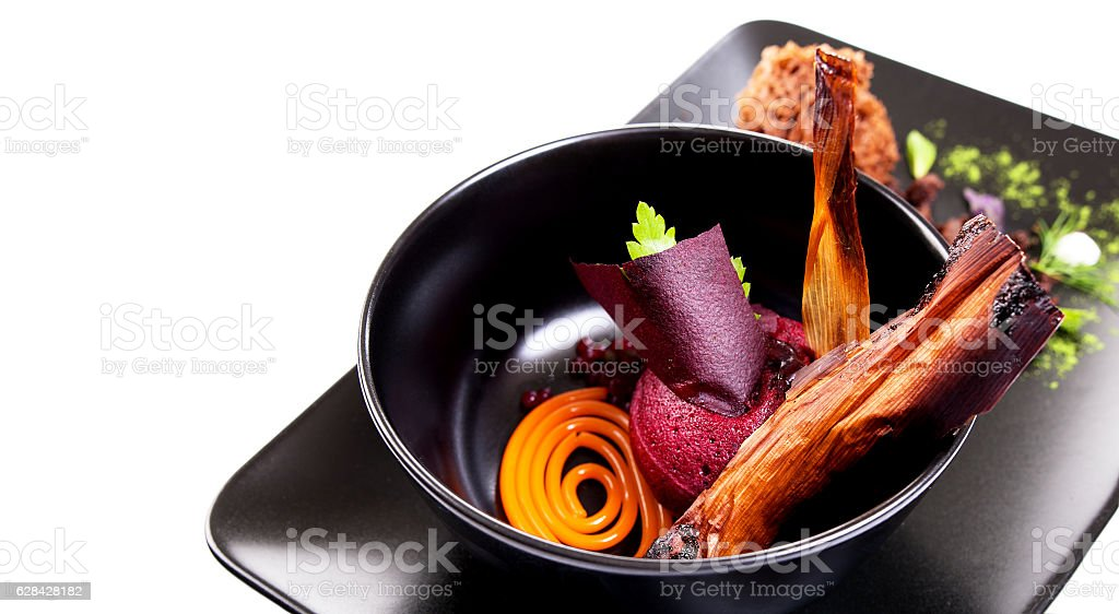 Molecular Cuisine. Delicious soup with beetroot. stock photo