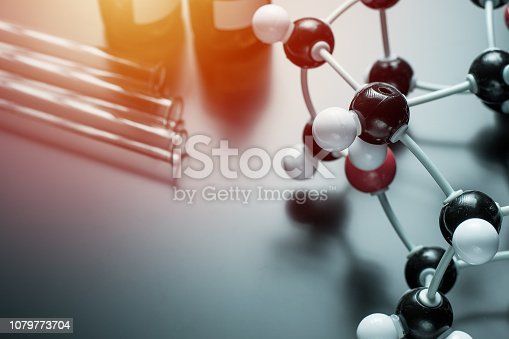 istock molecular formula and laboratory equipment on a blue background. Science organic chemistry concept 1079773704