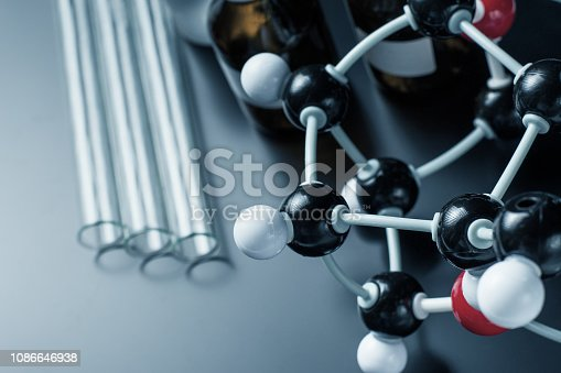 istock molecular formula and laboratory equipment on a dark background. Science organic chemistry concept 1086646938
