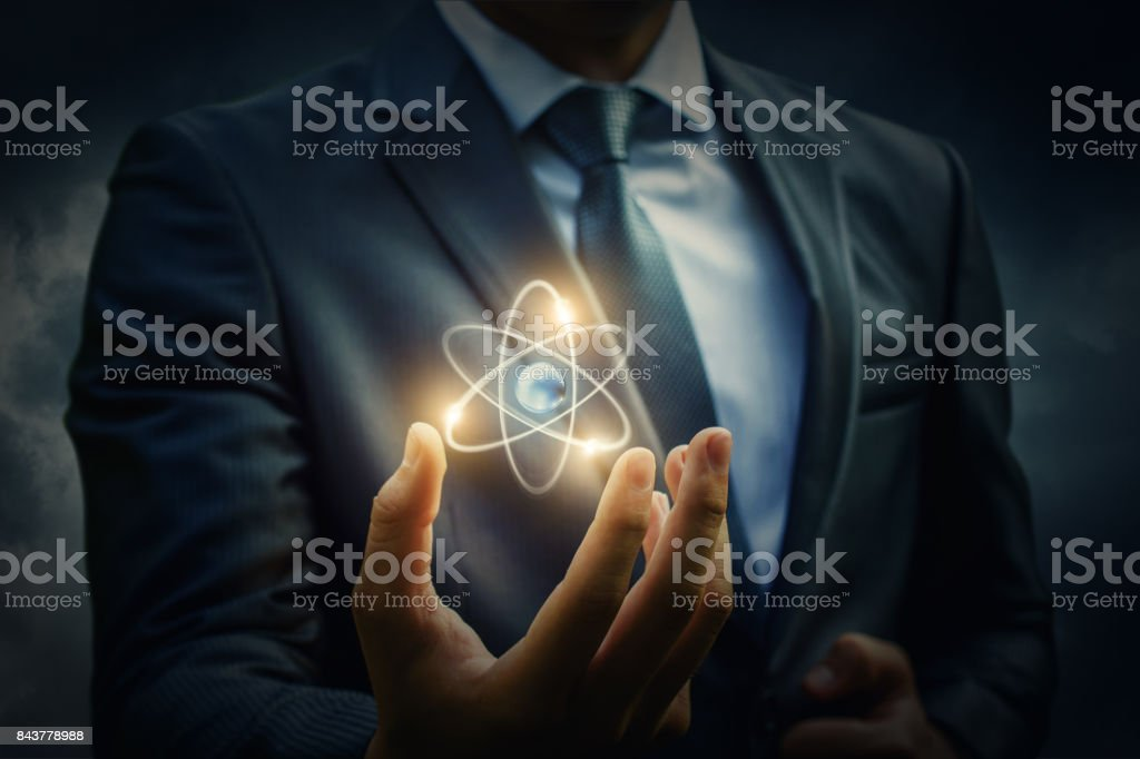 Molecule of an atom in the hand . stock photo