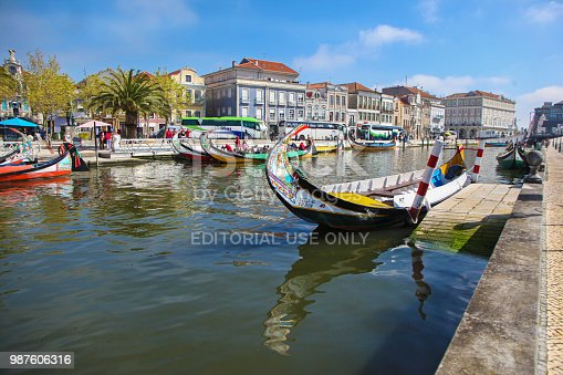 Cityscape of Aveiro, Portugal (also known as Portuguese Venice) with canals and traditional boats - Molicieros.