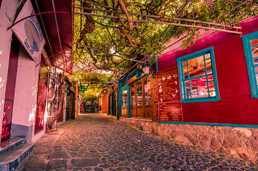 istock Molivos- the picteresque stone alley with the traditional shops which it was voted as the nicest alley of the world. 871126736