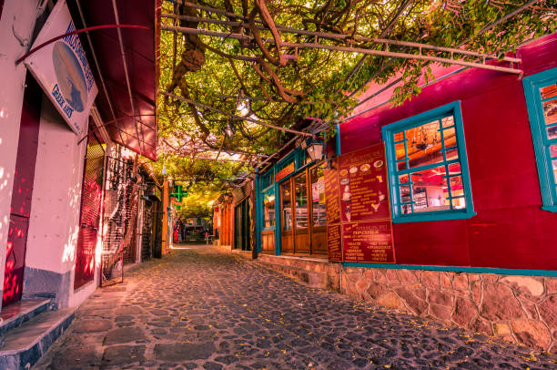 Molivos- the picteresque stone alley with the traditional shops which it was voted as the nicest alley of the world. stock photo