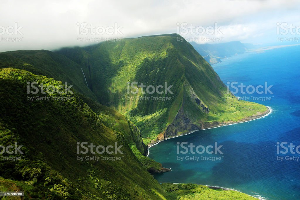Molokai island coast and Kahiwa falls (View from a helicopter) stock photo